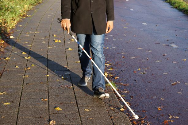 PIC  - Person walking with white cane